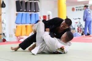 two person are exercising taekwondo